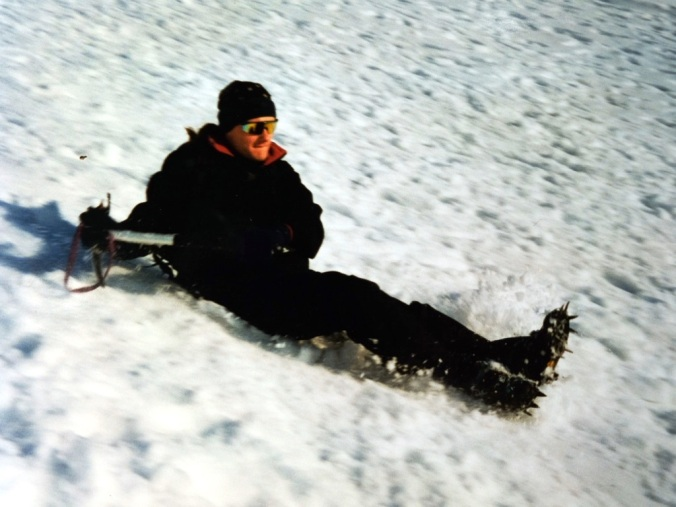 Nick sliding down the Ben using his iceaxe as a brake
